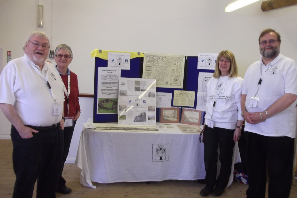 Some of our volunteers posing in front of the main table